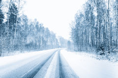 Snow-covered Open Road During A Snowstorm In Winter. Adverse Weather Conditions. Toned Filtered Photo Stock Photography