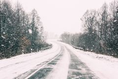 Snow-covered Open Road During A Winter Snowstorm. Adverse Weather