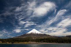 Osorno Volcano, a conical stratovolcano with dramatic cloudy blue sky in Los Lagos Region, Patagonia, Chile. Snow covered Osorno Volcano, a conical stratovolcano royalty free stock photo