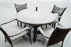 Snow covered outdoor patio furniture Stock Photography