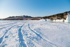 Snow covered over Baikal freeze water lake with clear blue sky background. Russia winter season Royalty Free Stock Image