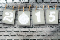 Snow-covered paper numbers of new 2015 Stock Image
