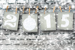 Snow-covered paper numbers of new 2015 with snow Stock Photo