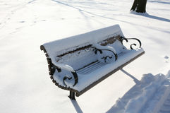 Snow covered park bench Royalty Free Stock Photography