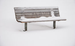 Snow Covered Park Bench Royalty Free Stock Image