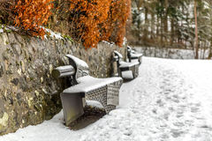 Snow covered park bench Stock Images