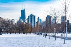 Snow Covered Park in Chicago with Skyline stock images