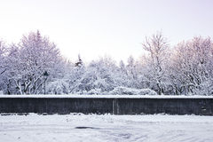 Snow covered park in the wintertime Stock Images