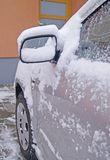 Snowy car rearview Royalty Free Stock Photos