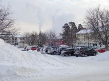 Snow covered parkinglot in center of Iggesund - Hudiksvall. Parkinglot covered by snow in wintertime in centre of Iggesund - Hudiksvall Stock Image