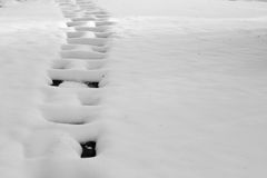 Snow covered path. A stone paved path is covered by snow stock photos
