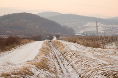 Snow covered path in winter countryside with mountains in backgr Royalty Free Stock Photos