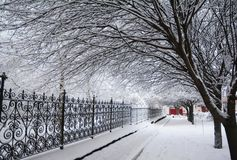 Snow Covered Pathway Winter. Snow Covered Pathway Along  Trees. Snow Covered Pathway Winter. Snow Covered Cozy Pathway Along Trees Royalty Free Stock Photos