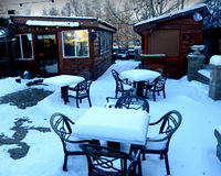 Snow Covered Patio Tables Stock Photos