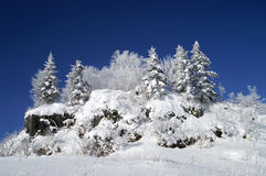 The snow-covered peak. World of ice and snow Royalty Free Stock Image