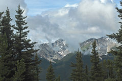 Snow Covered Peaks, Banff, Canada. This is one of the many spectacular views of the Rockies seen around Banff Royalty Free Stock Photography