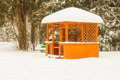Snow-covered pergola in the beautiful winter park. Horizontal photo, photo took in Russian, photo is usable on picture post card, calendar, gardening Royalty Free Stock Photos