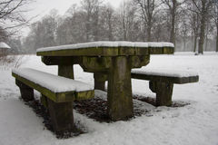 Snow covered picnic bench Stock Photos