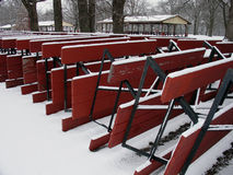 Snow covered picnic tables. Closeup of snow covered upturned picnic tables in park Royalty Free Stock Photos