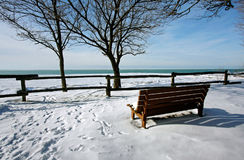 A snow-covered pier. On a frozen lake Royalty Free Stock Images