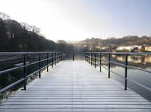 Snow Covered Pier Jetty over Lake Stock Photography