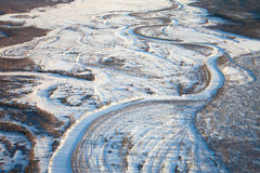 Snow covered plain with river Stock Photos