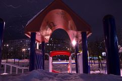 Snow-covered playground at night in the city in winter. royalty free stock photo