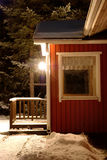 Snow-covered porch of the house and night lantern Royalty Free Stock Photo