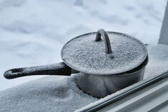 Snow covered pot on the window. Snowy pot lying on the window Stock Photos