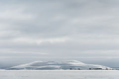 Snow covered Pseudo Crater in Iceland. Royalty Free Stock Photography