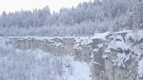 Snow-covered quarry in the woods. The woods in the snow. Bird`s eye view stock video footage