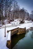 Snow covered railroad bridge over a creek in rural Carroll Count Stock Photos