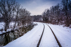 Snow covered railroad tracks and creek in rural Carroll County, Stock Photos
