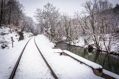 Snow covered railroad tracks and a creek in rural Carroll County Stock Images