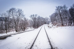 Snow covered railroad tracks in rural Carroll County, Pennsylvan Royalty Free Stock Image