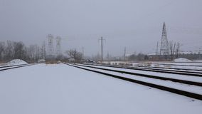 Snow covered railway crossing. Railway covered with snow stock footage