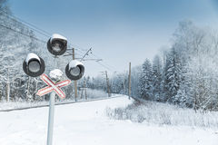 Snow covered railway crossing Stock Image