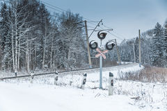 Snow covered railway crossing Stock Images