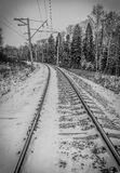 Snow covered railway crossing Royalty Free Stock Image