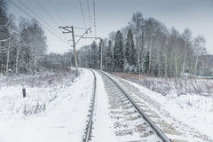 Snow covered railway crossing Stock Photography
