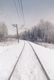 Snow covered railway crossing Royalty Free Stock Photos