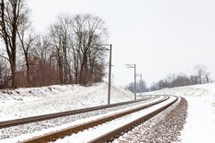 A Snow Covered Railway Track in Sigulda. The view along a snow covered railway track in Sigulda, Latvia Royalty Free Stock Photos