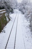 Snow Covered Railway Tracks and Stop Light Stock Image