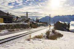 Snow covered railway tracks in a winter landscape Stock Image