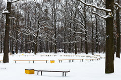 Snow covered recreation area in urban park Royalty Free Stock Images