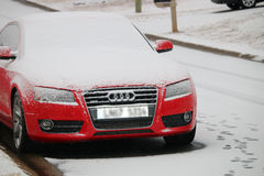 Snow-covered red Audi royalty free stock photos