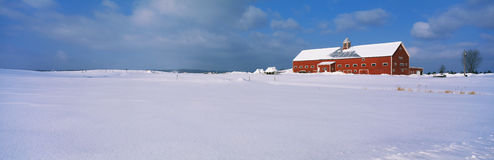 Snow covered red barn in New England Royalty Free Stock Photography