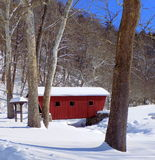 Snow Covered Red Bridge. A snow covered bridge that is the park entrance at Kent Falls in Connecticut Stock Image
