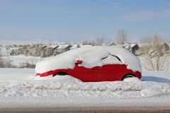 Snow covered red car Stock Photo