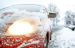 Snow Covered Red Sedan Stock Photography